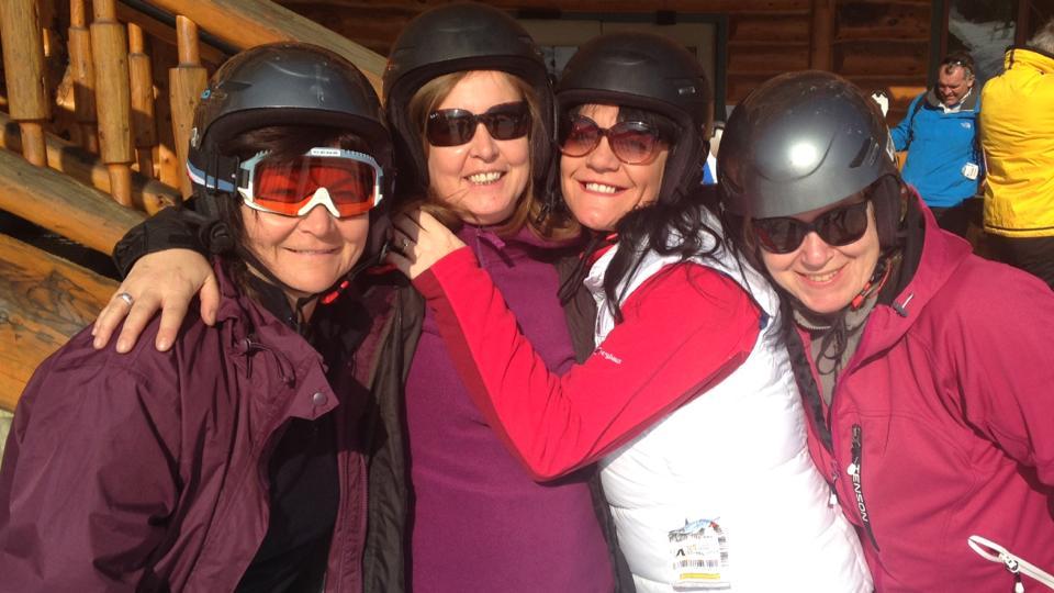 Gals skiing